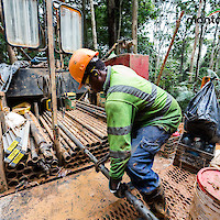 Worker at drilling site, Montagne d'Or